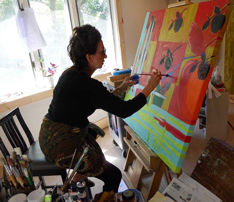 Kaen painting the Apple series